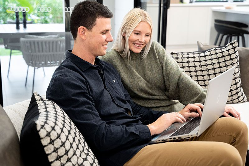 A Couple Looking at a Laptop